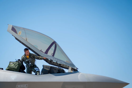 U.S. Air Force Capt. Michael Slotten, 61st Fighter Squadron F-35 student pilot, climbs into an F-35 Lighting II at Luke Air Force Base, Ariz., July 7, 2017. Slotten dropped GBU-12 Paveway II bombs for his first time from the F-35 during training at the Barry M Goldwater Range. (U.S. Air Force photo/Staff Sgt. Jensen Stidham)