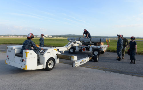 OKINAWA, Japan (Oct. 31, 2017) Sailors assigned to Patrol Squadron (VP) 8 use a forklift to transport an AGM-84D Harpoon missile to a P-8A Poseidon aircraft for onload at Kadena Air Base, Japan. VP-8 is currently deployed to the U.S. 7th Fleet area of responsibility conducting Intelligence, Surveillance, and Reconnaissance (ISR) and Anti-Submarine Warfare (ASW) missions, as well as providing maritime domain awareness to theater-level commanders. (U.S. Navy photo by Petty Officer 1st Class Jerome D. Johnson /Released)