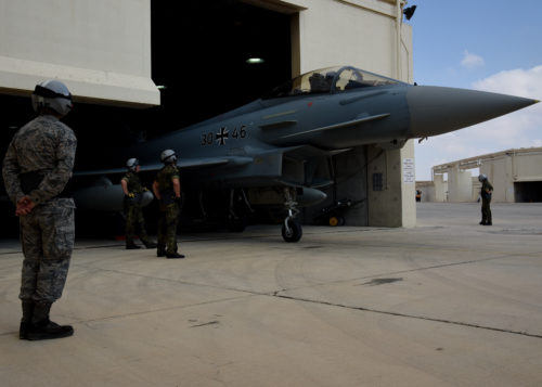 U.S. Air Force Senior Airman Cody Linholm, left, 510th Aircraft Maintenance Unit crew chief, watches two German air force crew chiefs prepare a German Eurofighter Typhoon for a morning sortie at Uvda Air Force Base, Israel, Nov. 8, during Blue Flag 17. The goal of Blue Flag is to exercise military partnerships and strategic cooperation. (U.S. Air Force photo/Senior Airman Abby L. Finkel)