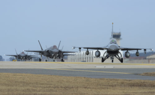 A U.S. Air Force F-16 Fighting Falcon and four F-35A Lightning IIs assigned to the 34th Expeditionary Fighter Squadron Hill Air Force Base, Utah, taxi toward the end of the runway during exercise VIGILANT ACE 18, Dec. 3, 2017, at Kunsan Air Base, Republic of Korea. The Airmen from the 34th EFS deployed to Kadena Air Base, Japan in October, and sent Airmen and aircraft to participate in the week-long, annual VIGILANT ACE exercise in support of the Mutual Defense Treaty between the U.S. and Republic of Korea. (U.S. Air Force photo by Senior Airman Colby L. Hardin)