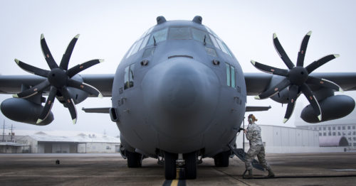 A 153rd Airlift Wing maintainer plugs in a generator cable into her C-130H after arriving at Eglin Air Force Base, Fla., Jan. 11. Air Force's first fully upgraded C-130H is here for test and evaluation on its new modified propeller system and engines. (U.S. Air Force photo/Samuel King Jr.)