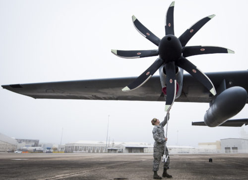 Staff Sgt. Ethan Mulhern, 153rd Airlift Wing maintainer, places a cover over a C-130H engine intake after arriving at Eglin Air Force Base, Fla., Jan. 11. Air Force's first fully upgraded C-130H is here for test and evaluation on its new modified propeller system and engines. (U.S. Air Force photo/Samuel King Jr.)