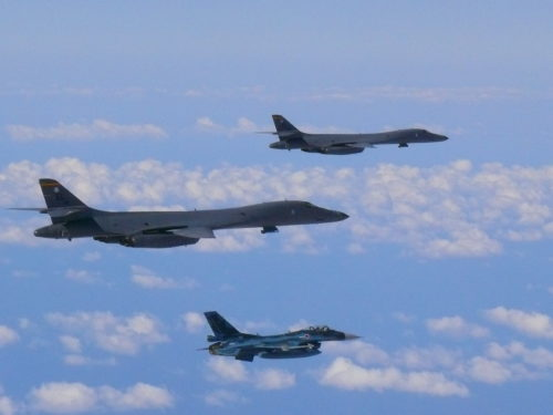 Two U.S. Air Force B-1B Lancer bombers assigned to the 37th Expeditionary Bomb Squadron, deployed from Ellsworth AFB, South Dakota, fly alongside a Koku Jieitai (Japan Air Self-Defense Force) F-2s over the vicinity of the East China Sea, Oct. 21, 2017. Following the flight with Koku Jieitai the Lancers continued on to participate in a flyover for the 2017 Seoul Aerospace & Defense Exhibition (Seoul ADEX 17) at Seoul Airport, Republic of Korea. (photo courtesy of Koku Jieitai [Japan Air Self-Defense Force])