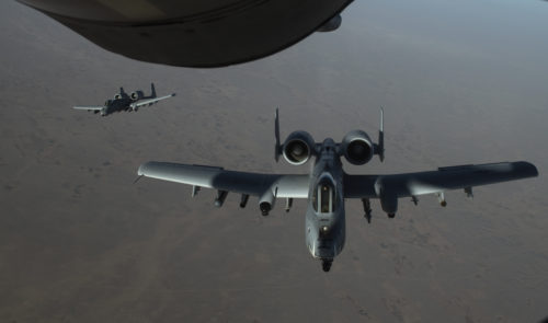 Two U.S. Air Force A-10 Thunderbolt IIs depart after receiving fuel from a KC-135 Stratotanker, assigned to the 340th Expeditionary Air Refueling Squadron Detachment 1, during a refueling mission over Afghanistan, Feb. 7, 2018. U.S. Air Forces Central Command realigned airpower to USFOR-A Combined- Joint Area of Operations (CJOA) to support increased operations in support of the Resolute Support Mission and Operation Freedom's Sentinel. (U.S. Air Force Photo by Tech. Sgt. Paul Labbe)