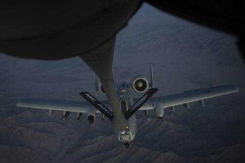 A U.S. Air Force A-10 Thunderbolt II receives fuel from a KC-135 Stratotanker assigned to the 340th Expeditionary Air Refueling Squadron Detachment 1 during a refueling mission over Afghanistan, Feb. 7, 2018. The A-10s recently deployed to Kandahar Airfield where its ability to deliver a wide variety of precision munitions and devastating firepower from its 30mm cannon make it an excellent choice to support the increased airpower requirement in Operation Freedom's Sentinel. (U.S. Air Force Photo by Tech. Sgt. Paul Labbe)