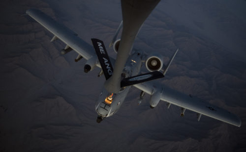 A U.S. Air Force A-10 Thunderbolt II receives fuel from a KC-135 Stratotanker, assigned to the 340th Expeditionary Air Refueling Squadron Detachment 1, during a refueling mission over Afghanistan, Feb. 7, 2018. The A-10s fly as part of the 303rd Expeditionary Fighter Squadron at Kandahar Airfield, Afghanistan. (U.S. Air Force Photo by Tech. Sgt. Paul Labbe)