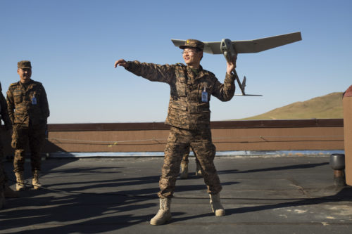 Mongolian Armed Forces Lt. Col. B. Baasaadorj practices the steps of launching an unmanned aerial vehicle May 27 during the UAV training portion of Khaan Quest 2016 at Five Hills Training Area near Ulaanbaatar, Mongolia. The training equipped MAF members with a deeper understanding of the purpose and operations of UAVs and how they can be used during peacekeeping missions. Khaan Quest 2016 is an annual, multinational peacekeeping operations exercise hosted by the Mongolian Armed Forces, co-sponsored by U.S. Pacific Command, and supported by U.S. Army Pacific and U.S. Marine Corps Forces, Pacific. Khaan Quest, in its 14th iteration, is the capstone exercise for this year's Global Peace Operations Initiative program. The exercise focuses on training activities to enhance international interoperability, develop peacekeeping capabilities, build to mil-to-mil relationships, and enhance military readiness. (U.S. Marine Corps Photo by Cpl. Janessa K. Pon)
