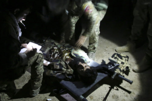 Afghan National Army soldiers with 7th Special Operations Kandak, 215th Corps provide medical care to a notionally wounded soldier during night casualty evacuation training at Camp Shorabak, Afghanistan, Sept. 10, 2017. Approximately 65 soldiers with the unit rehearsed and refined their CASEVAC process in the dark, which simulated realistic training in preparation for potential real-world operations. (U.S. Marine Corps photo by Sgt. Lucas Hopkins)