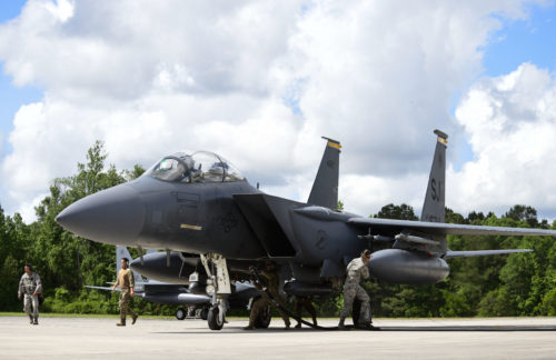 USAF security forces learn how to refuel the F-15E while